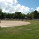 Softball Very Popular with Crowd and Kids