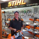 Mike holding on of the STIHL chainsaws in store.