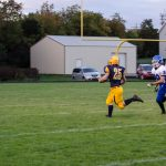 Negaunne breaks away with the ball for the first touch down against Ishpeming