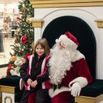 This little girl was very pleased to see Santa.