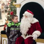 Telling Santa what he wants this year for Christmas.