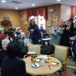 The Mill Creek got together to sing some Christmas carols