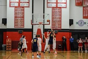 The Negaunee Miners Boys Basketball Team lost 57-53 against the Marquette Redmen at the end of four quarters on Sunny.FM.