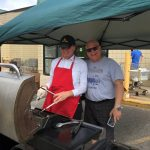 Owner and GM of Great Lakes Radio Todd Noordyk helping out Super One Marquette's master griller.