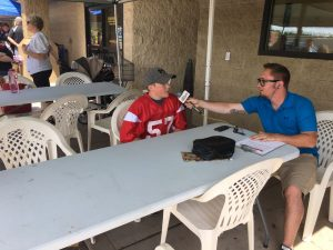 Ryan interviewing player, Ashton Demboski.