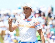 Rickie Fowler ties record with a 65 to start the U.S. Open.