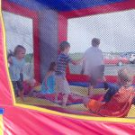 Kids enjoy Double Troubles Bouncy slide and house that were brought along.