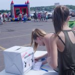 Kids entering a prize drawing to win a free basketball hoop.