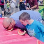 looks like Dad is winning this watermelon eating contest.