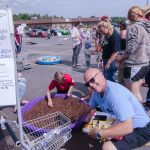 """The """"Major"""" fishing for coins at Tadych's Econo Foods Kids Day."""