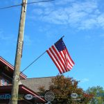 Beautiful American Flag on a beautiful day 70 degrees, low humidity, mostly clear skies.