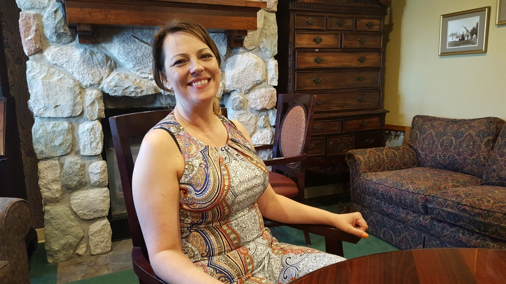 Terri at the fireplace in the lobby.