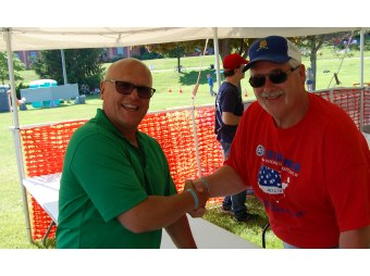 Todd Noordyk Shakes Hand with Geno Angeli of the Marquette County Exchange Club