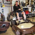 Mike sitting in the Grasshopper with a front end attachment.