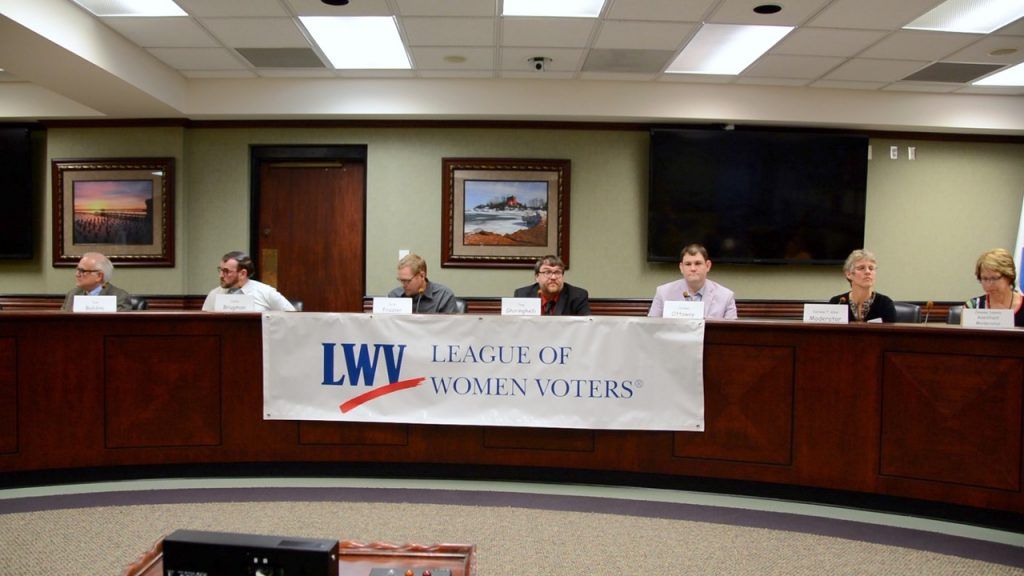 Left to right: (Candidates) Tom Baldini, Justin Brugman, Peter Frazier, Tony Ghiringelli, and Jeremy Ottaway, and LWVs Darlene Allen (moderator, LWV) and Jeanne Sekely (assistant moderator, LWV) (Photographer: David Allen, LWV)