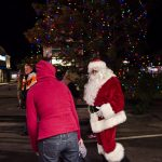 Santa greeting visitors.