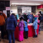 People were checking out the UPAWS Apparel store.