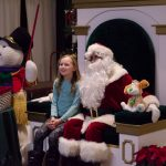 Santa was having a great time talking to all of these kids.