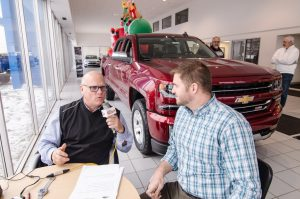 Andy Grundstrom and Major Discount chatting about pre-owned Trucks.