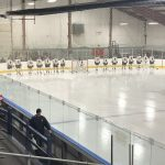 Negaunee Miners Hockey team lining up for the game.