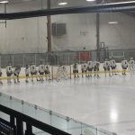 Negaunee Miners Hockey getting ready for their game against the Kingsford Flivvers.