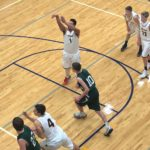 Luke Mattson shooting a free-throw for the Negaunee Miners in the Miners VS Manistique Emeralds game.