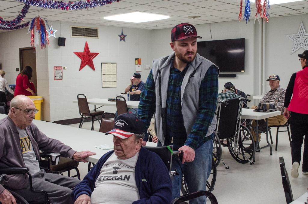 People slowly filled into the room for Christmas is for Veterans!