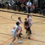 Jason Sager has the ball in this pic. Miners VS Houghton Gremlins Bball game.