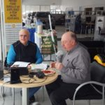 Owner Jim Grundstrom and Major Discount setting up to broadcast from Frei Chevrolet.