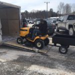 Unloading the mower at Frei Chevrolet.