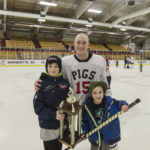 #15 - Adam Maynard from the Pigs with his two sons and the trophy.