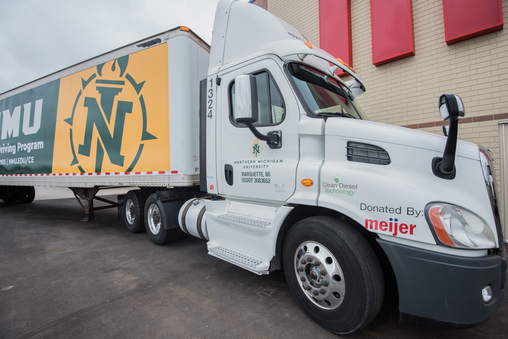 Meijer of Marquette Donates Two Semi-Trucks and Trailers to NMU's
