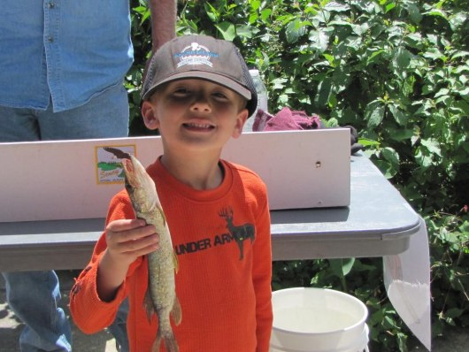 ackson Lasik showng off his catch during Children's Fishing Day at Seney National Wildlife Refuge. Faye Slater - USFWSl