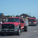 The rescue and fire department vehicles lead the way.