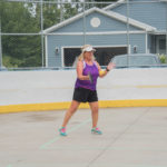 Trying to learn pickleball on the ice rink.