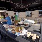 Guests enjoyed a brat or hotdog, chips, cookies and cold drinks.
