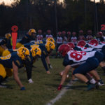 The Negaunee Miners and Westwood Patriots line up for the first play of the game.