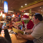 The grinch enjoying some time at Applebee's