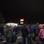 People were starting to gather in the Applebee's parking lot.