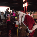 Santa gave out lots of hugs as he made his way to the stage.