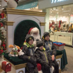 These three boys got their family picture with Santa.