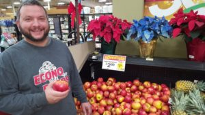 Zach showing off the rare SugarBee Apples at Econo Foods.