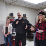 Kelsey and Walt from Great Lakes Radio with D.J. Jacobetti Activities Coordinator Sherri Smith.