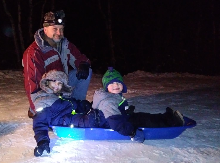 Kelsey's dad, son, and nephew (Ken Niemisto, Holden Reyes, and Titan Bradbury) sledding at Al Quaal, The Sunny Morning Show