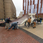 Model of a giant prehistoric pterosaur is rolled toward the U-M Biological Sciences Building, the new home of the university's Museum of Natural History. The museum will reopen in its new home next spring. Photo by Roger Hart/Michigan Photography.