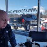 Jim Grundstrom, owner of Frei Chevrolet invites you need to the warm showroom.