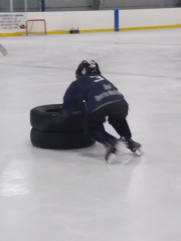 Holden in the midst of a hockey drill