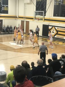 Both teams battle in the paint in Iron Mountain's 54-42 defeat of Negaunee