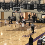Gladstone looks to score inside, as they defeated the Negaunee Miners 43-39 o