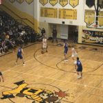 Negaunee takes the ball up the court in their win over Ishpeming.